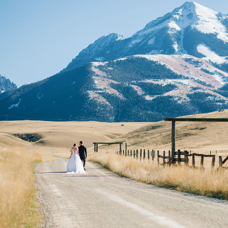 bride and groom with mountain