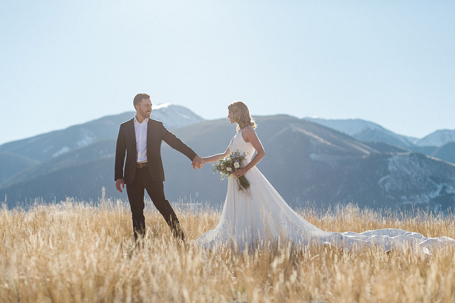 couple in grass with mountain