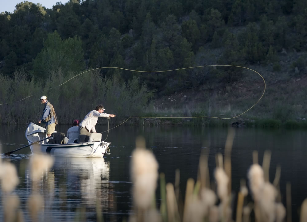 fly fishermen in a boat
