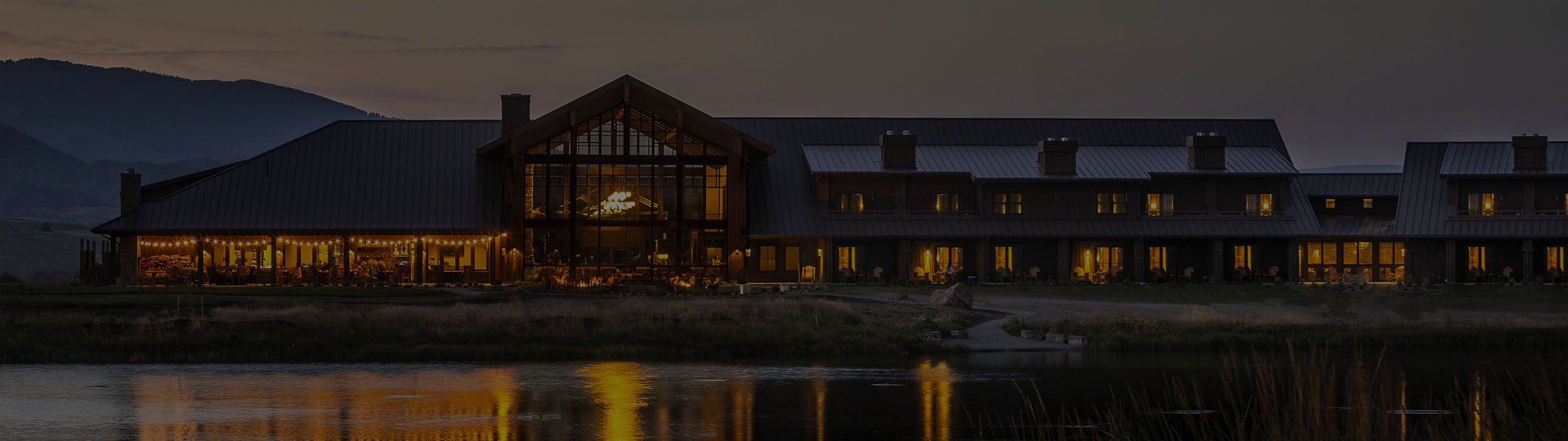 Sage Lodge and pond at dusk