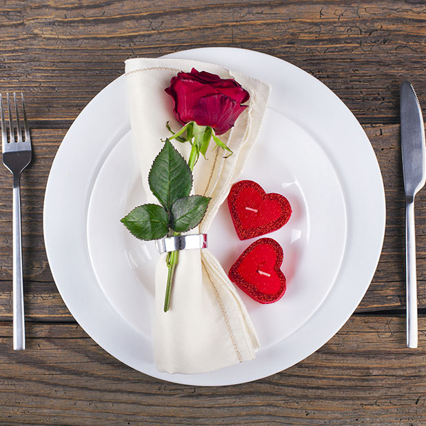 Heart candles and rose place setting