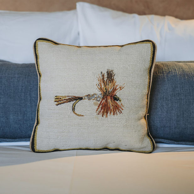 fly fishing pillow on bed