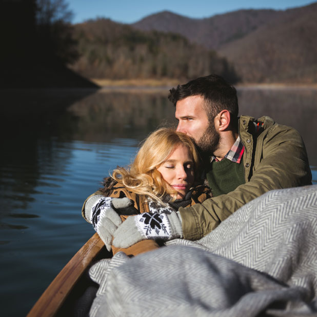 couple snuggling in a boat